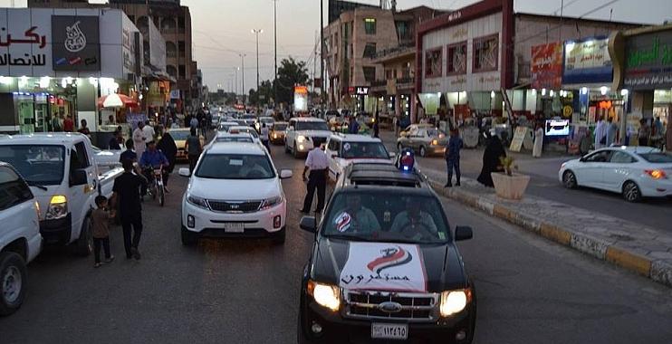 واسطيون يجوبون شوارع الكوت في حملة لترشيد استهلاك الكهرباء